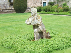 "Statue of Morris, Abbotsford - This garden is called ""The Morris Garden"" after this statue, whose sculptor John Greenfield died before he could complete it, and which was presented to Abbotsford in 1850 by William Lockhart of Milton, who was the half-brother of Mr Hope-Scott, Sir Walter's son-in-law. Morris is on his knees begging forgiveness from Helen MacGregor-Campbell after being implicit in giving over her husband Rob Roy to the authorities."