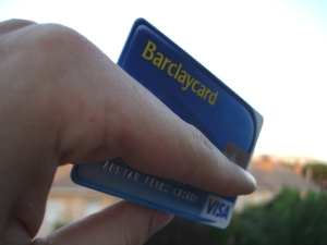 Close-up of a Barclaycard credit card in someone's hand.