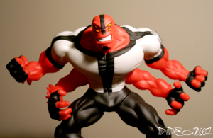 "A red, four-armed alien action figure from the ""Ben 10"" toy line."