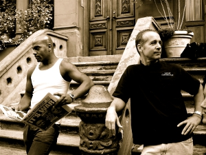 Sepia photo of neighbors on their front walk in Harlem, N.Y.
