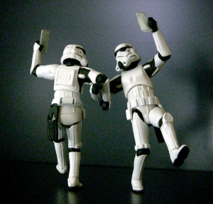 Two Star Wars Stormtrooper actions figures posed, dancing arm-in-arm.
